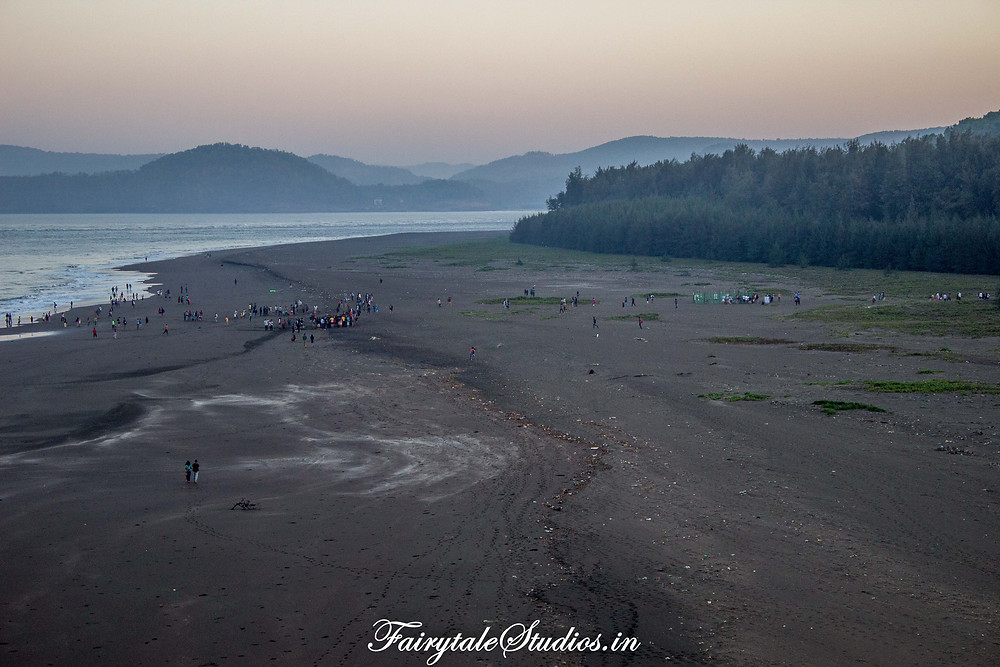The velas beach at early hours on a sunday morning during the Turtle Festival. On right we can see the crowd gathered near the conserved area for turtles