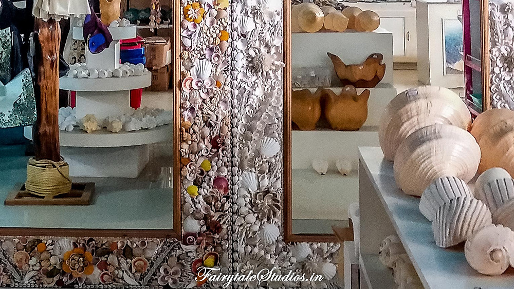 Lovely mirror decorated with sea shells for sale at Seashell museum, Mahabalipuram