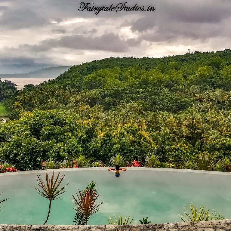 Appreciating the beauty of nature from the infinity pool at Kahani Paradise - luxury villa in Gokarna