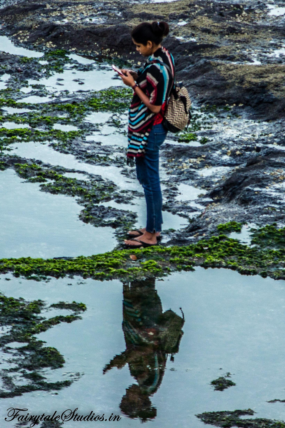 Reflection of a girl looking for mobile network