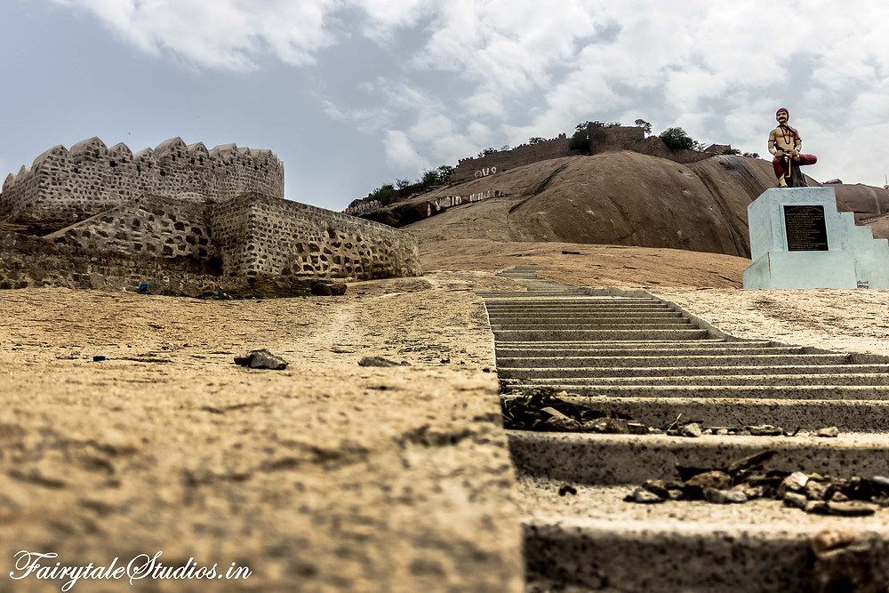 Steps leading to Bhongir Fort on the top of the monolithic rock with statue of Sardar Sarvai Panappa on right