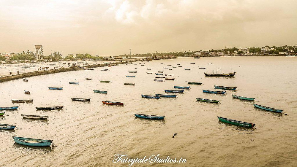 Boats parked across this stretch of sea in Diu at early morning
