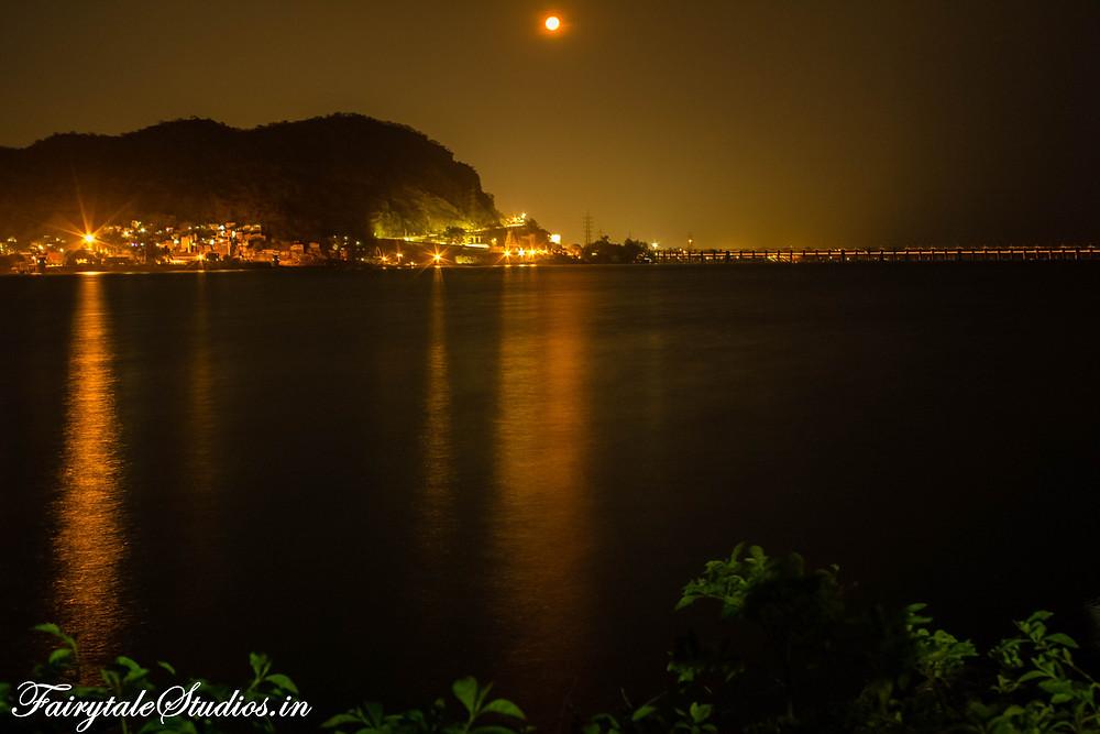 Vijayawada with Prakasam Barrage in night as seen from Bhavani Island