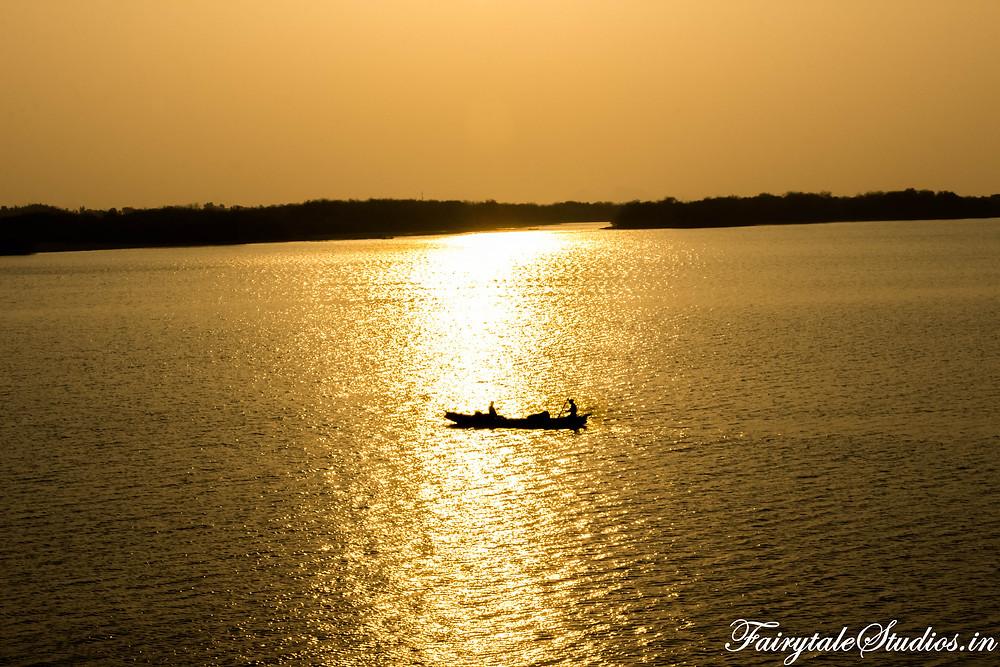 The serenity of the sunset and grandeur of Krishna river in Vijayawada is breathtaking