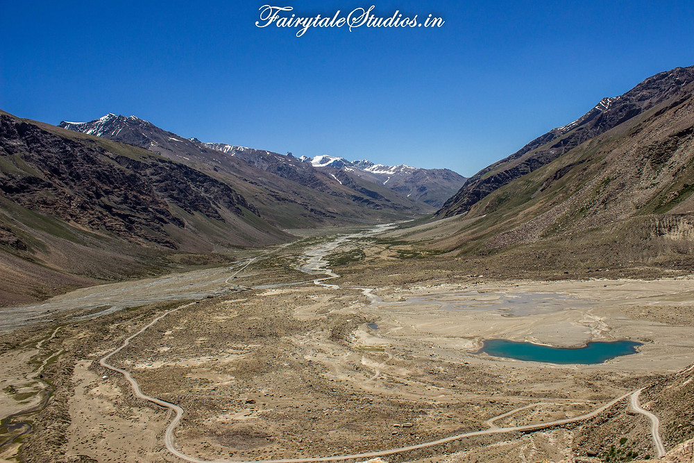 The vast plains which lead to Padum with streams of water criss crossing and a narrow road cutting through (The Zanskar Odyssey Travelogue)