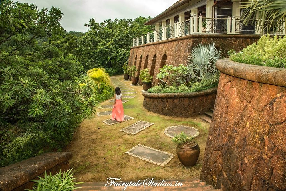 The exterior made up of red laterite rocks giving a castle-like look to Kahani Paradise - luxury villa in Gokarna