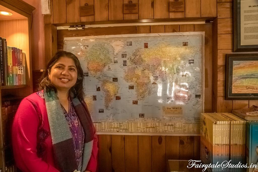 Ms. Sunita Kudle, host at La Villa Bethany proudly showing off her life's earnings marked on the world map at Landour (near Mussoorie), Uttarakhand - India
