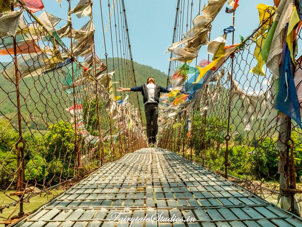 Suspension bridge ladden with colorful Buddhist flags, Bhutan