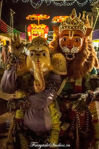 People dressed as lion and elephant god Ganesh participating in Dussehra carnival of Srisailam