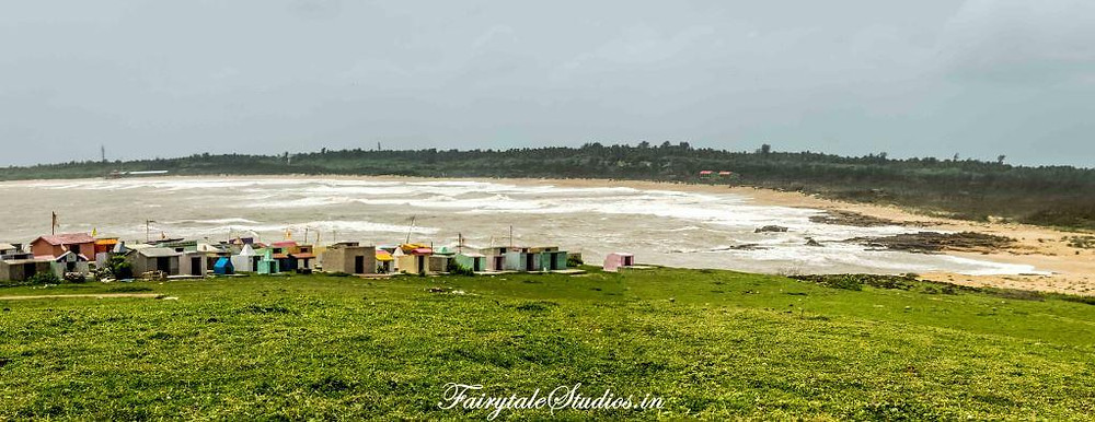 Colorful houses in distance on the way to our hidden cliff in Diu