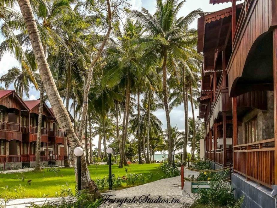 Beach side of Summer Sands beach resort with neil ocean suites on 2 sides with garden leading to beach