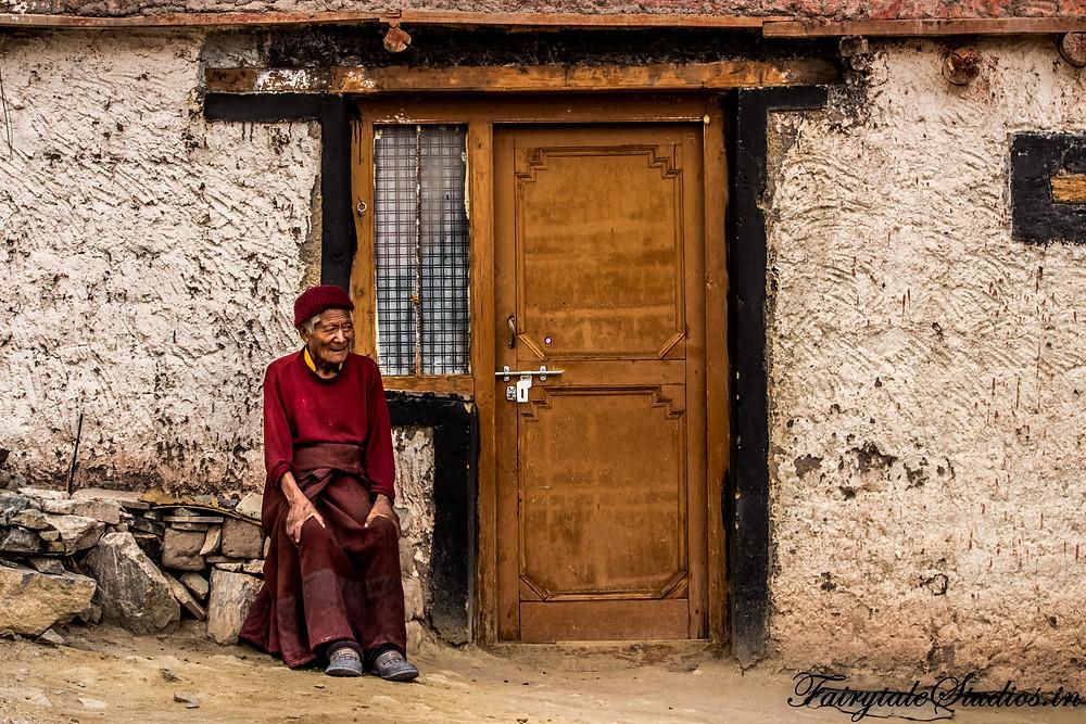 A monk sitting outside his home near Stakna Monastery (The Zanskar Odyssey)