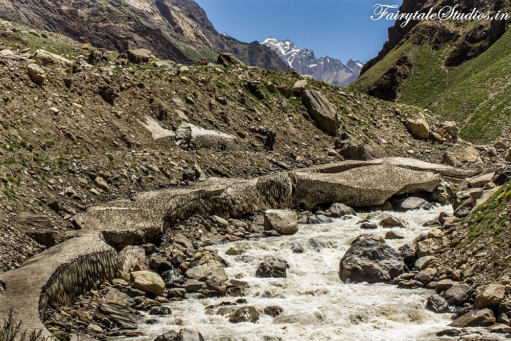 Another glacier partly melted, partly dirtied by soil curving across Suru river (The Zanskar Odyssey Travelogue)