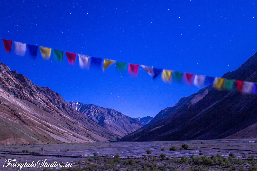 Thoughts came pouring in as the vastness of this universe and masculinity of our existence dawned on me below the Buddhist prayer flags(The Zanskar Odyssey Travelogue)
