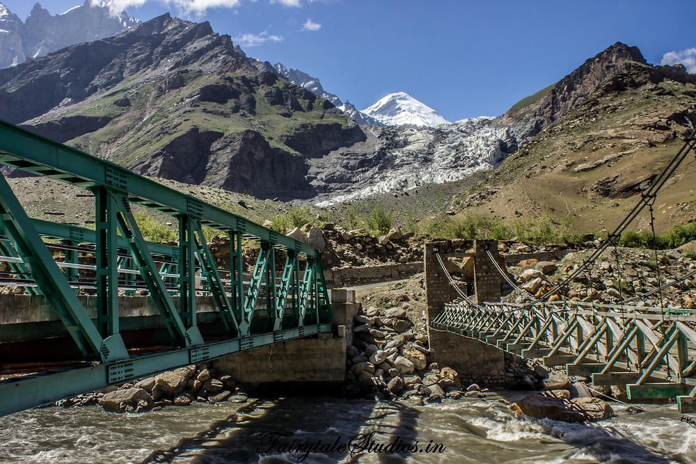Parkachik Glacier drenched in dirt with Nun/Kun in the back (The Zanskar Odyssey Travelogue)