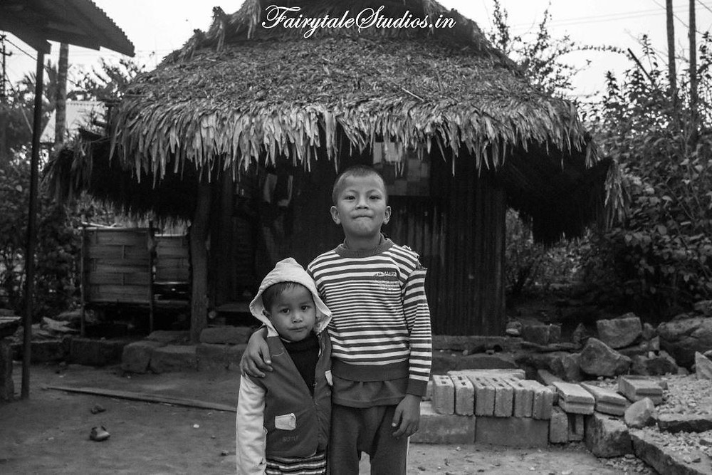 2 fun loving brothers happy to pose at Mawlynnong, Meghalaya, India