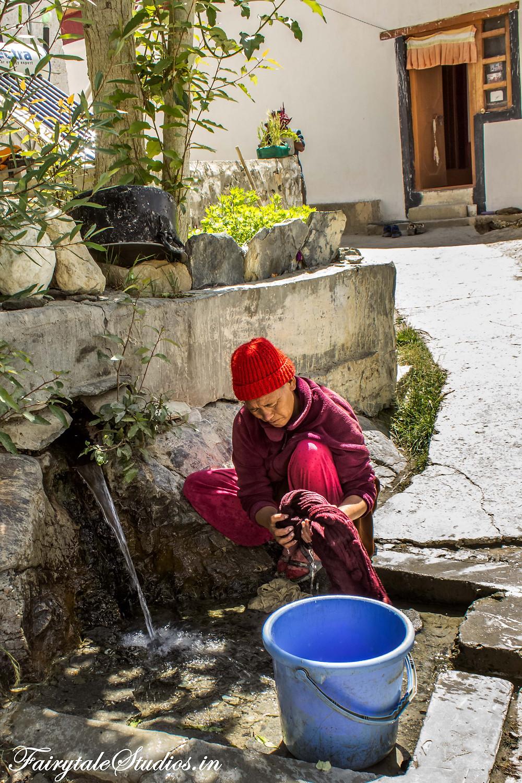 A nun focusing on her daily chores in Zangla Nunnery (The Zanskar Odyssey Travelogue)