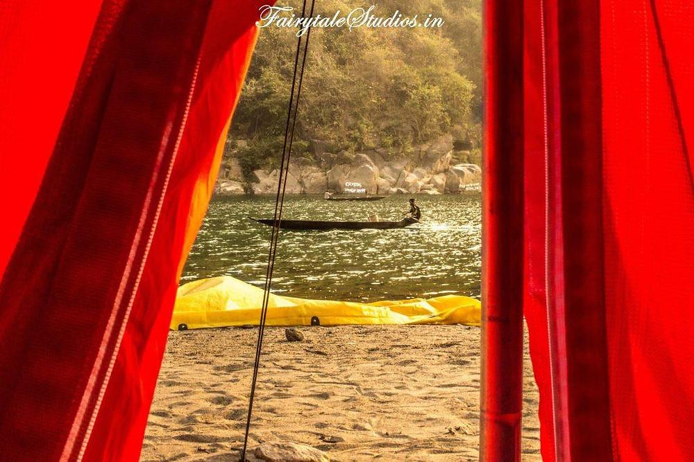 Waking up besides Umngot river while camping with pioneer adventures at Shnongpdeng, Meghalaya