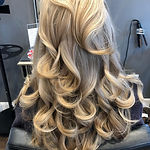 blonde highlights blow-dry bouncy curls.
