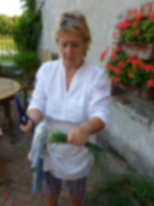 Luisa picking chives