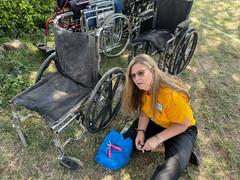 Wheelchair adjustment by Advisor Shelly Petersen