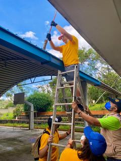 Rainwater gutter cleaning crew