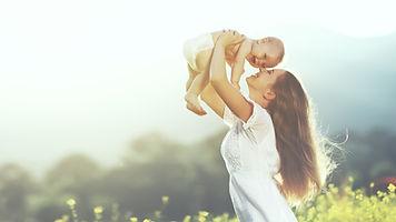 happy harmonious family outdoors. mother