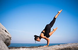 Personal Development - healthy girl doing yoga pose.