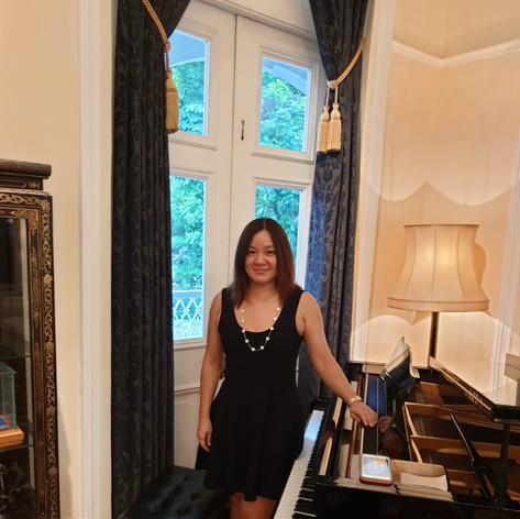 Cheryl performing at the British High Commisioner's residence at Nassim Road