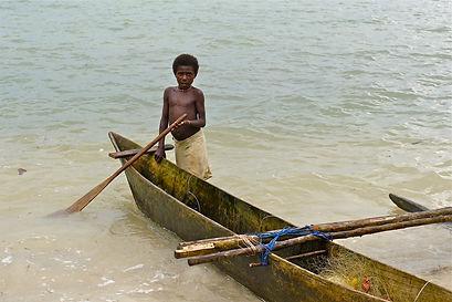 solomon islander next to boat.jpg