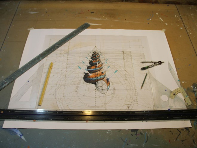 Araujo works from a drafting table with basic tools like a ruler compass and protractor. Image: Rafael Araujo