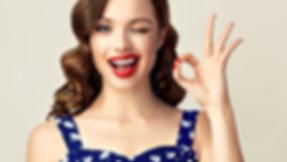 Pin-up retro girl with curly hair  winki