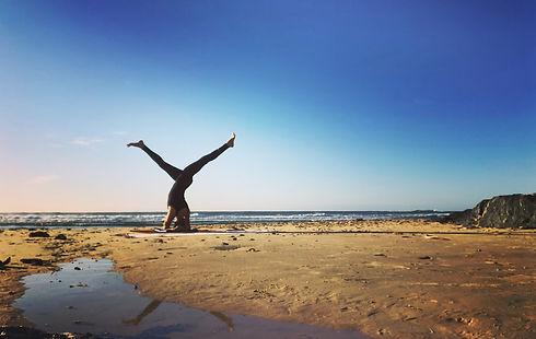 Parsva Sirsasana beach cropped.jpg