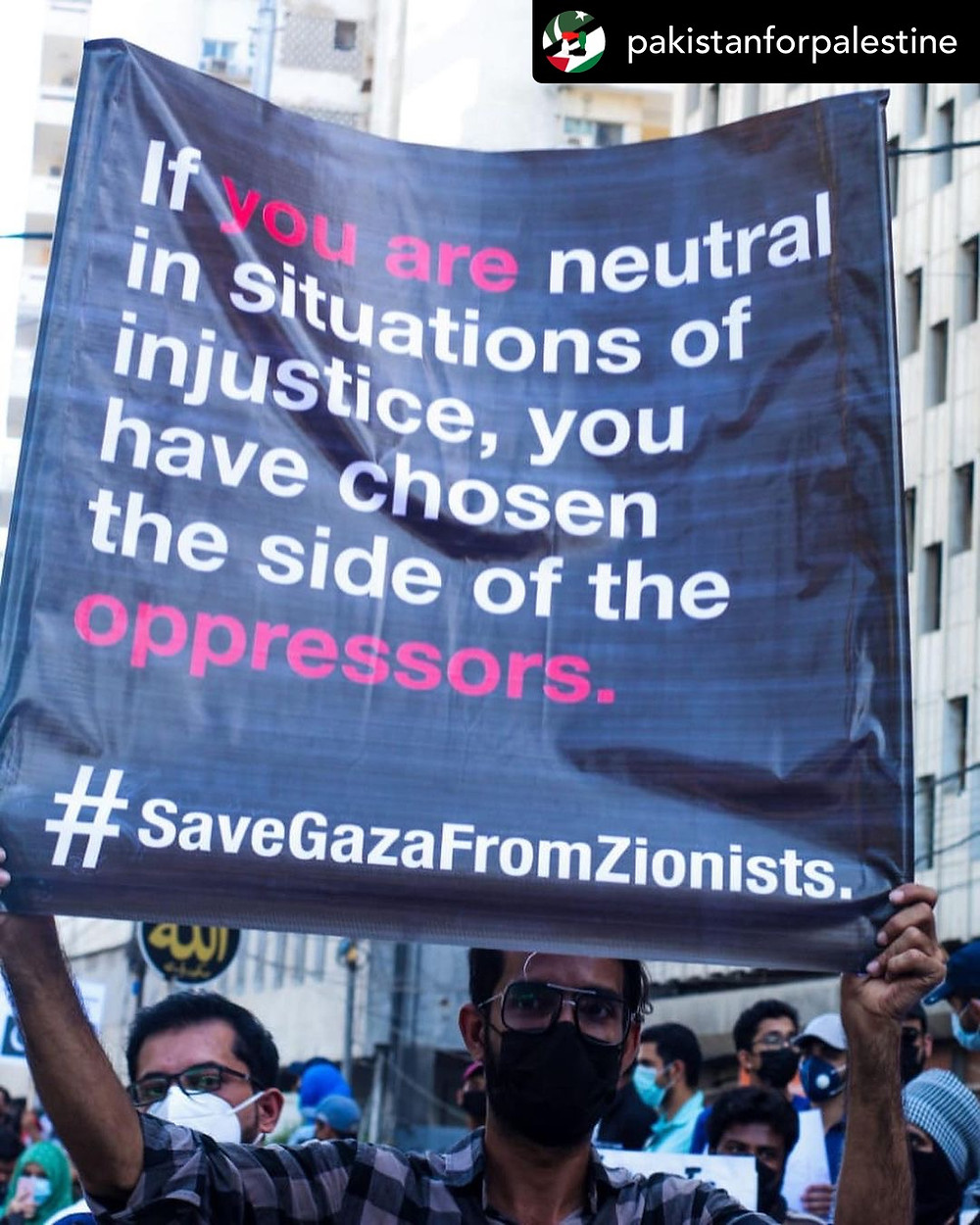 A protestor displaying their placard in Pakistan for Palestine Protest, May 19th, 2021