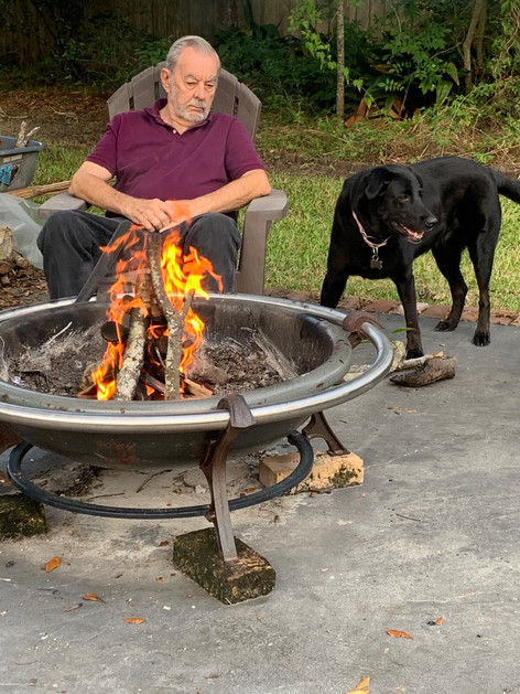 Joe and Lola relaxing by the fire after a hardworking day in the studio.