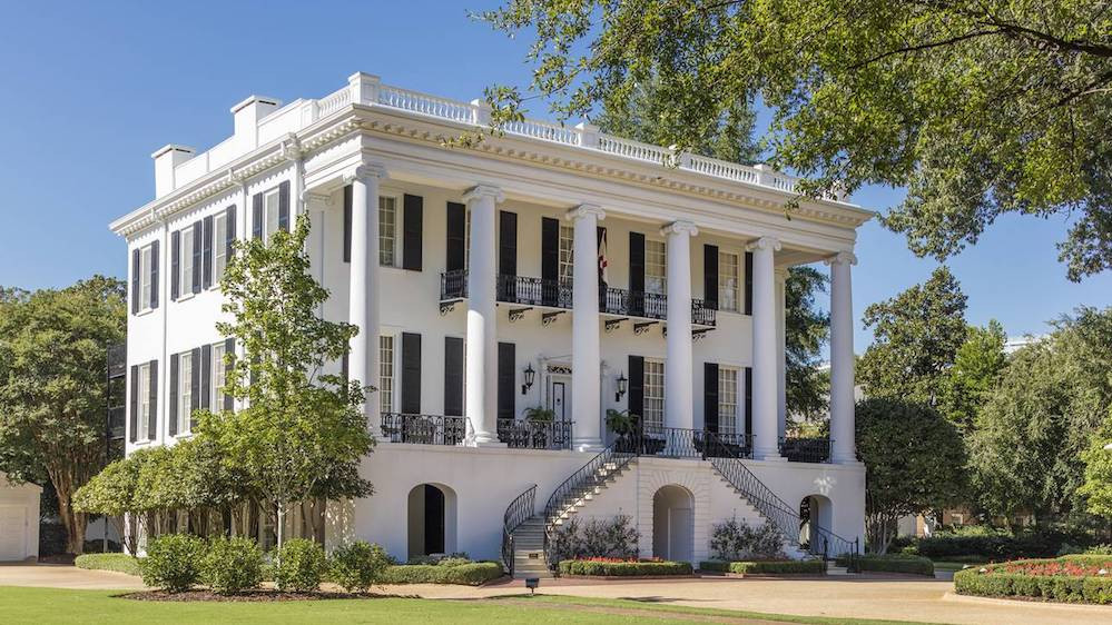 The President's Mansion at the University of Alabama, one of the few campus buildings to survive the Civil War, sits directly across the street from the campus's iconic Denny Chimes, which, according to Susan Bell, ring every 15 minutes, 24 hours a day. 'Once you get used to those chimes,' she says, 'they're a very beautiful sound to hear.'