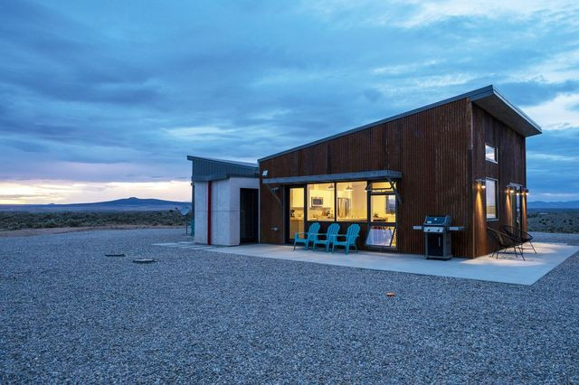 Austin and Randall Slimps' two-bedroom weekend home in Taos, N.M. A butterfly-shaped roof funnels rainwater to two large cisterns.