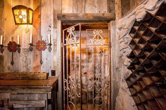 Salvaged iron gates wine cellar