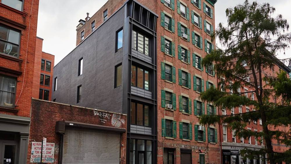 This narrow townhouse at 267 ½ Water St. in Manhattan measures 2,706 square feet and has three bedrooms.