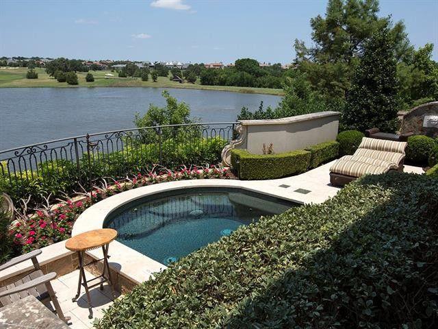 Pool overlooking lake in Westlake, TX