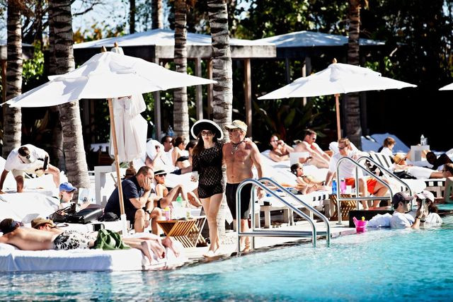 Residents and guests crowd the pool area at Miami's Residences at W Hotel South Beach.