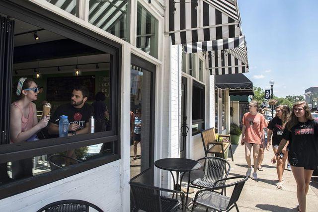 Emma Sheedy, far left, eats ice cream with Austin Snider at Fresh Local Ice Cream on Sunday in Apex, N.C.
