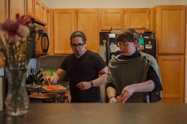 Alex Ruiz and Stephanie Johnson cook dinner in their apartment in Asheville, N.C.