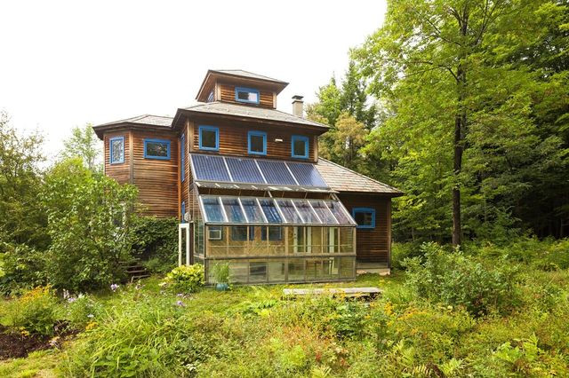 Ashley and Jack Adamant own a solar-powered home with an attached greenhouse on 30 acres outside Montpelier, Vt.