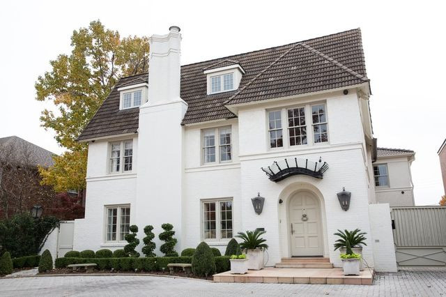 Leigh and Michael Bornitz purchased a home in 2008 and completed a 1 1/2-year renovation. The home has a French country-style exterior with a built-in ornamentation over the doorway.