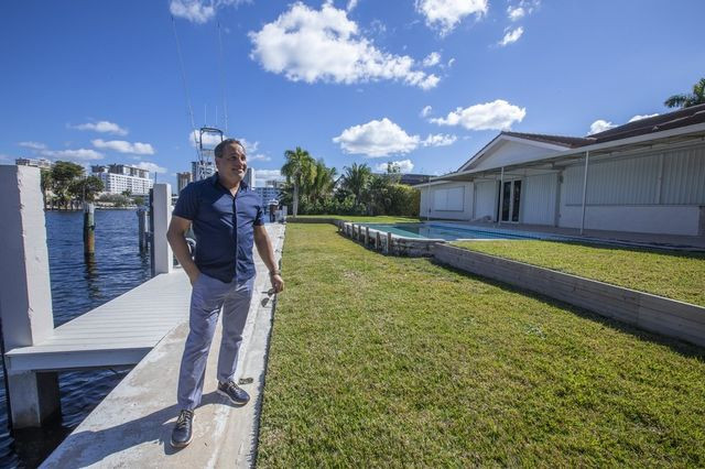 Troy Ippolito, 43, behind the house he grew up in along a canal in Hallandale Beach.