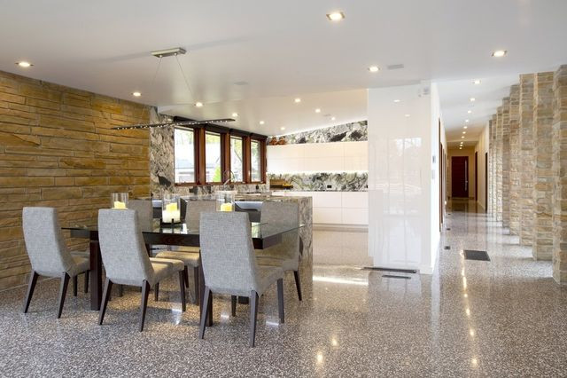 The kitchen and dining area of Julie and Steve Freeman's Bentonville home. During an extensive renovation, the couple wanted to keep the home's original Midcentury feel.