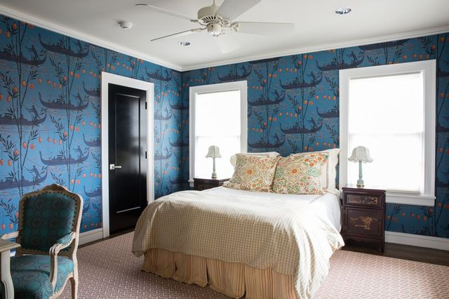 A Venetian-themed wallpaper adds color to the guest room.