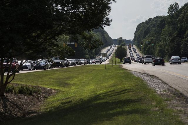 Commuters line up on en route to Raleigh, N.C., from the suburban town of Apex.