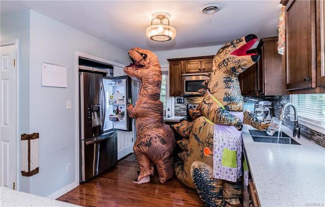 Listing photos with T-rex costumed people